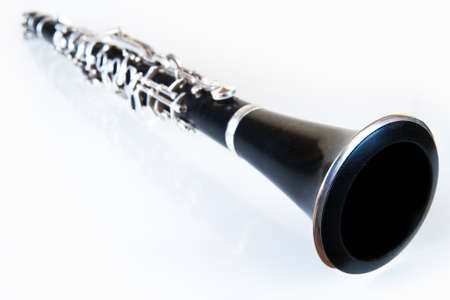 perspective of a black classic music clarinet with silver environment Stock Photo