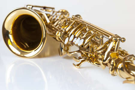golden concert saxophone on white background photo