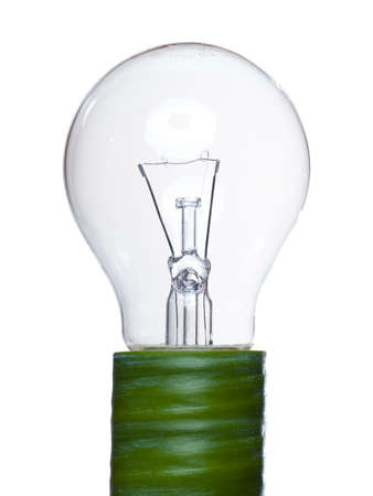 a light bulb with a green leaf as symbol for clean renewable energy on white background  photo