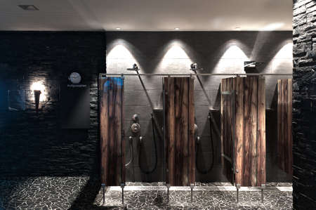 modern shower in a swimming pool with optical wooden plexi glass divider Standard-Bild