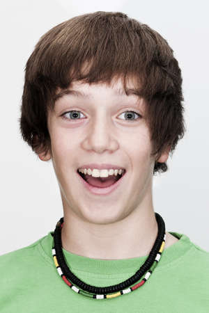 astonished: potrait of young guy which has is mouth open with visible teeth on white background