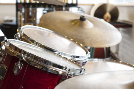 drum set: view on two drums and plates kit with wood visual apperance