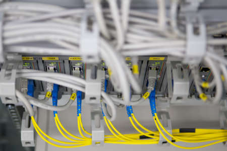 IT equipment with yellow fiber glass adapters to ethernet environment photo