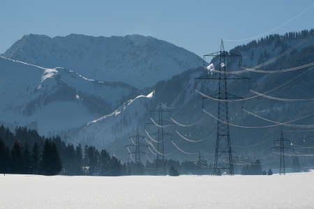 several power poles in a winter landscape with a lot of snow and mountains Stock Photo - 12771871