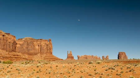 monument valley at dreamy summer day and moon with deep blue sky Stock Photo - 13126630