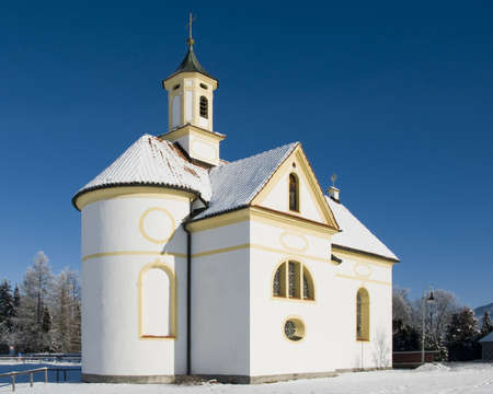 small church or chapel at wonderful winter day with blue sky photo
