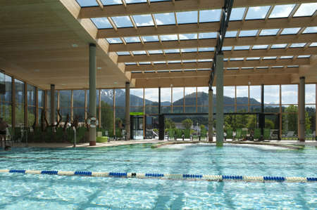 indoor architecture of public swim bath with laps and glass roof