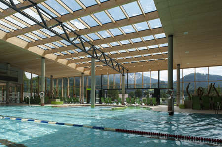 lap of luxury: indoor architecture of public swim bath with laps and glass roof