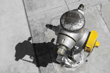 colorkey of an american fireplug hydrant standing at a pavement photo