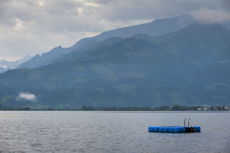 lake zell am see at morning with blue swimming island stage photo