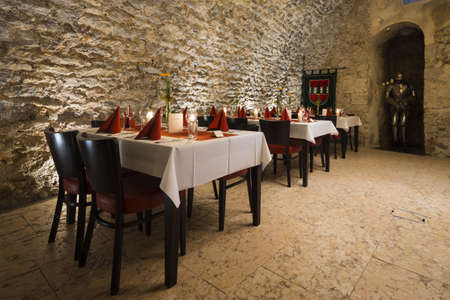 romantic arch stonewall in knight room with tables and candlelit photo
