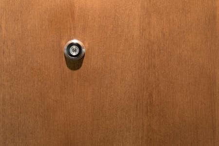 doorstep: door viewer in wooden wing Stock Photo