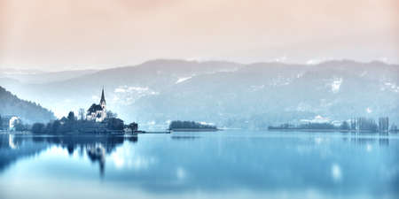 dreamy church maria-Wörth on island in lake wörthersee photo