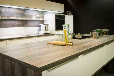 view into modern wooden optic kitchen work plate with decoration