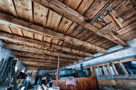 old farm storage room with junk and wooden ceiling Stock Photo - 26223235