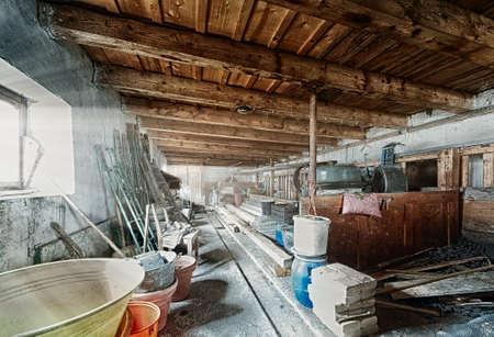 old barn storage room with light beams through window Standard-Bild