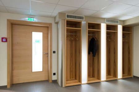 garderobe: wooden illuminated garderobe next door with clothes hanger
