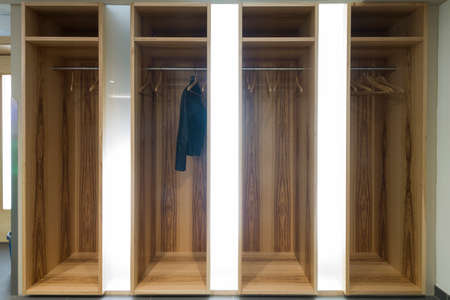 garderobe: illuminated garderobe with one single jacket on hanger
