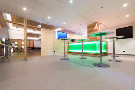foyer: low view to wooden foyer with illuminated bar desk