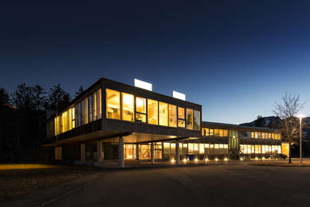 office building exterior: ecological energy saving wooden office building at night