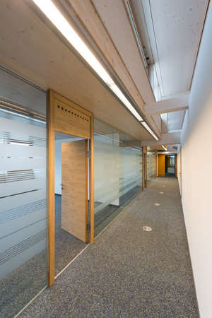 corridor of a modern office building with glass and wood Stock Photo