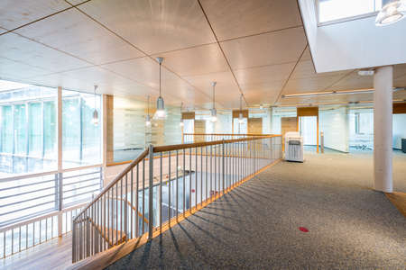 bright wooden lobby hall of modern office building photo