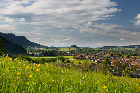 wonderfull: view to wonderfull village of pfronten with fresh meadow at spring Stock Photo