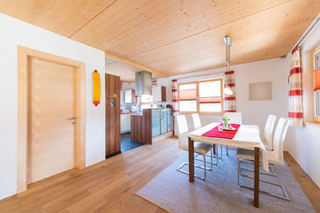 wooden warm mud of kitchen and dining room in timber house photo