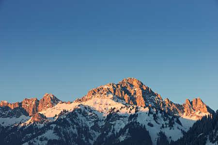 tirol: glowing orange mountain peak at sunset in tirol alps