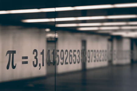 constant: the pi symbol and numbers of mathematical constant on glass Stock Photo