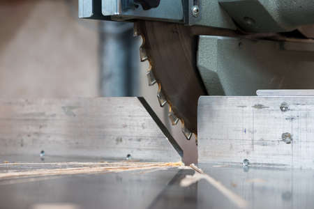 miter: detail of fixed  circular buzz miter saw blade and table Stock Photo