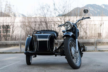 sidecar: frontview of black old  oldtimer motorcycle with sidecar