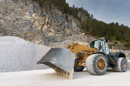wheel loader: huge wheel mounted front loader at stone quarry