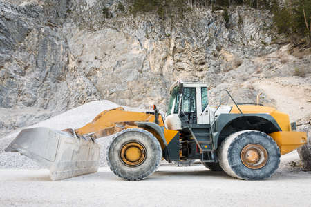 front loader: side view of large and heavy wheel mounted front loader at mine Stock Photo