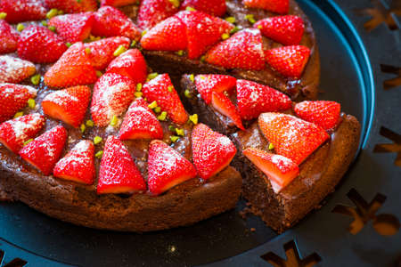 self indulgence: self made piece of fresh baked strawberry chocolate cake on plate Stock Photo