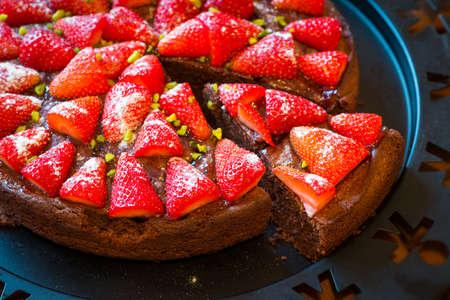 self indulgence: self made piece of fresh baked strawberry chocolate cake on plate Stock Photo