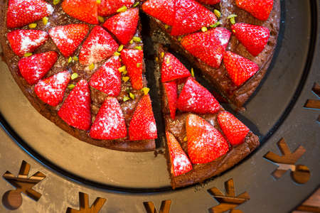 strawberry chocolate: top view on fresh selfmade baked strawberry chocolate cake