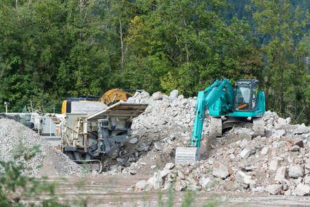 breaker: stone breaker and shovel digger on demolition site