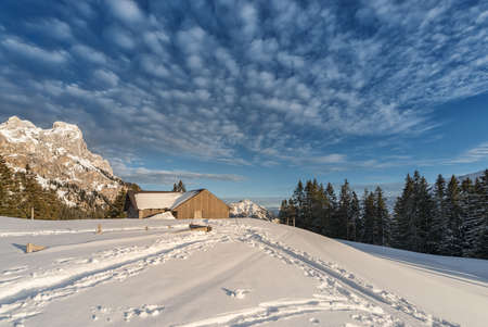 chalet: chalet with snow on austrian mountain at sunny winter day Stock Photo