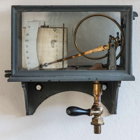 hygrometer: old retro hygrometer weather station at wall Stock Photo