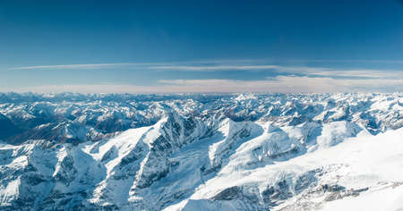 aerial: snowy mountain peaks in cold tirol austria at winter Stock Photo