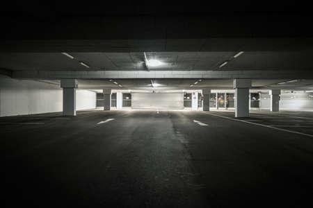 sectional door: underground parking garage with view to sectional door Stock Photo
