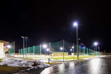 sports field: training soccer field with flood light at night in winter