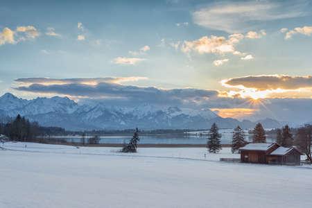 sunset lake: winter sunset landscape witk lake mountains and trees