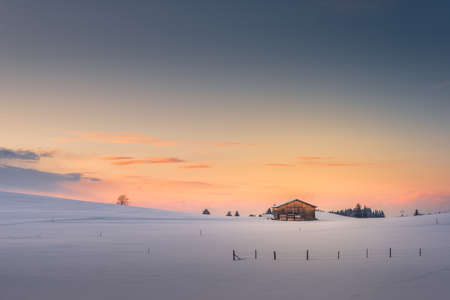 afterglow: single hut at afterglow sunset sky in winter