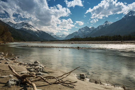 sand bank and stony river lech at tirol mountains  with blue sky Stock Photo