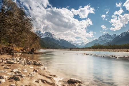stony: sandy and stony river bank with cold water in austrian mountain valley Stock Photo
