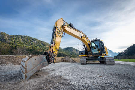 huge heavy shovel excavator digger  on gravel construction site Stock Photo