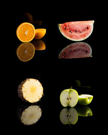 collage of four vitamin C fruits on black background Stock Photo