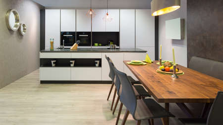kitchen island: flat white kitchen with island unit and wooden dinner table